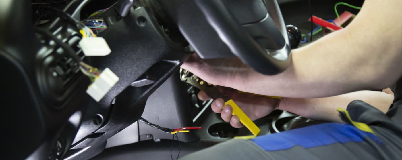 Mechanic testing a vehicle using diagnostics software - Car Electrical Repairs Poole
